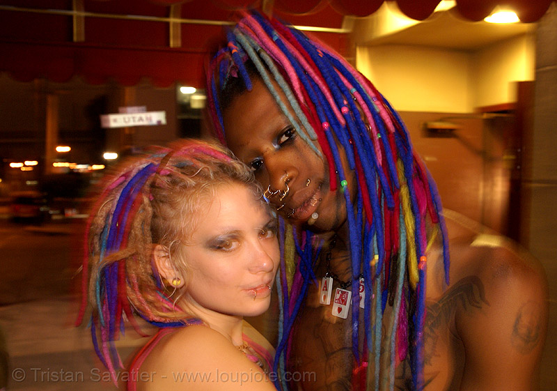 penny and page from the church of the perpetual party (san francisco), blue, church of the perpetual party, couple, dreadlocks, dreads, man, night, page turner, penny arcade, perpetual-party.com, piercing, pink, qp, woman
