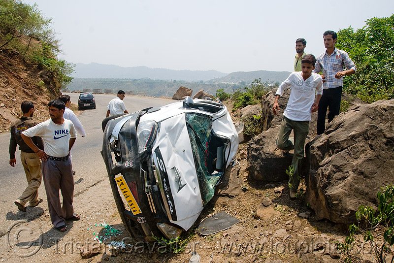 people around overturned car, car accident, car crash, kashmir, overturned car, road, rollover, tata indica, tata motors, traffic accident, white, wreck