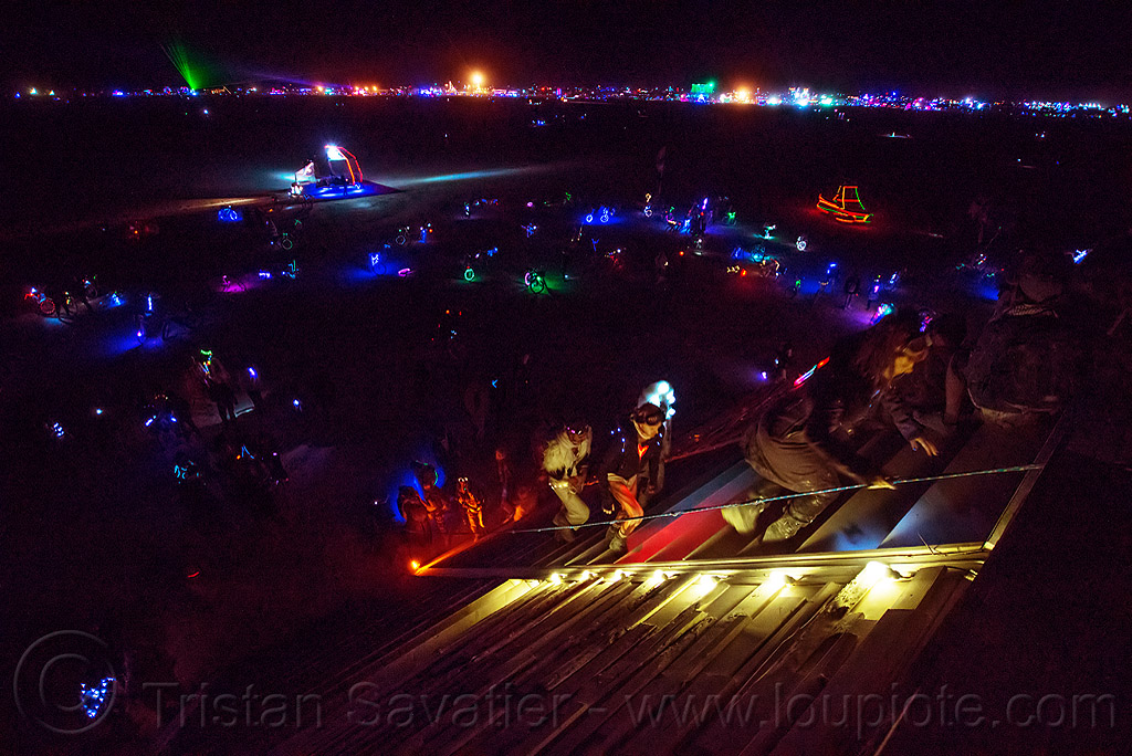 people climbing the giant pyramid at night - burning man 2016, art installation, burning man, catacomb of veils, climbing, glowing, night, pyramid, sculpture