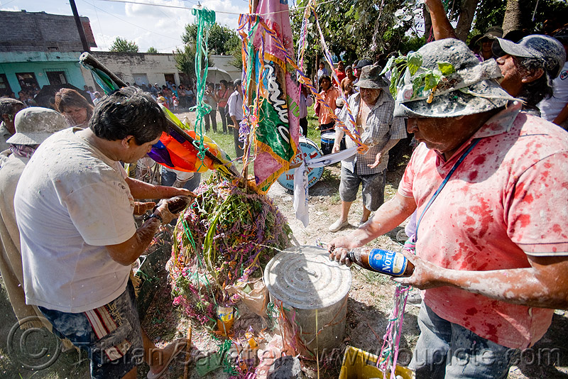 people offering beer to pachamama - apacheta - carnaval - carnival in jujuy capital (argentina), andean carnival, apacheta, argentina, jujuy capital, man, noroeste argentino, pachamama, san salvador de jujuy