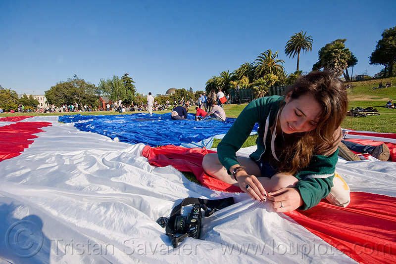 phoebe sewing the giant american flag - dolores park (san francisco), american flag, camera, dolores park, giant flag, mending, phoebe, photographer, sewing, stitching, the flag project, us flag, woman