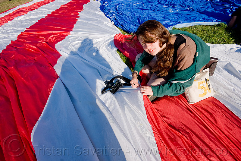 phoebe sewing the giant american flag - dolores park (san francisco), camera, giant flag, mending, people, photographer, stitching, the flag project, us flag, woman