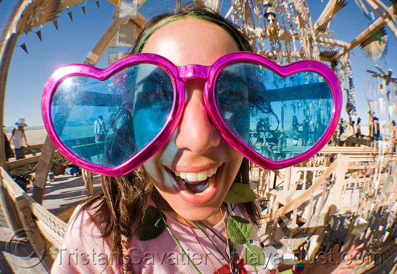 photo of girl with oversize heart sunglasses - baby G - burning man 2008, allison, baby g, blue, burning man, novelty sunglasses, oversize sunglasses, pink, twinkle, woman