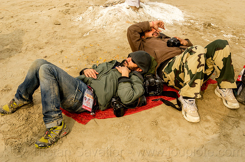 photographers napping - jordano cipriani - kumbh mela 2013 (india), cameras, hindu pilgrimage, hinduism, india, jordano cipriani, lying down, maha kumbh mela, men, napping, press pass, press photographers, resting, sleeping