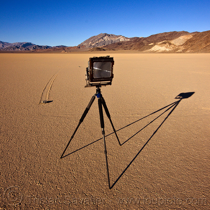 photographing a sailing stone on the racetrack - death valley, camera, chamber, cracked mud, desert, dry lake, dry mud, film camera, large format, mountains, moving, moving rock, photographic chamber, playa, racetrack playa, shadow, sliding, sliding rock, track, tripod