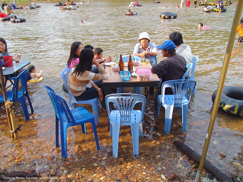 picnicking on the beach - river fair - tha ton - near fang (thailand), beach, bottles, family, festival, inner tubes, picnic, picnicking, plastic chairs, river bath, river bathing, river fair, river tubing, sitting, songkran, table, tha ton, water, ประเทศไทย, สงกรานต์
