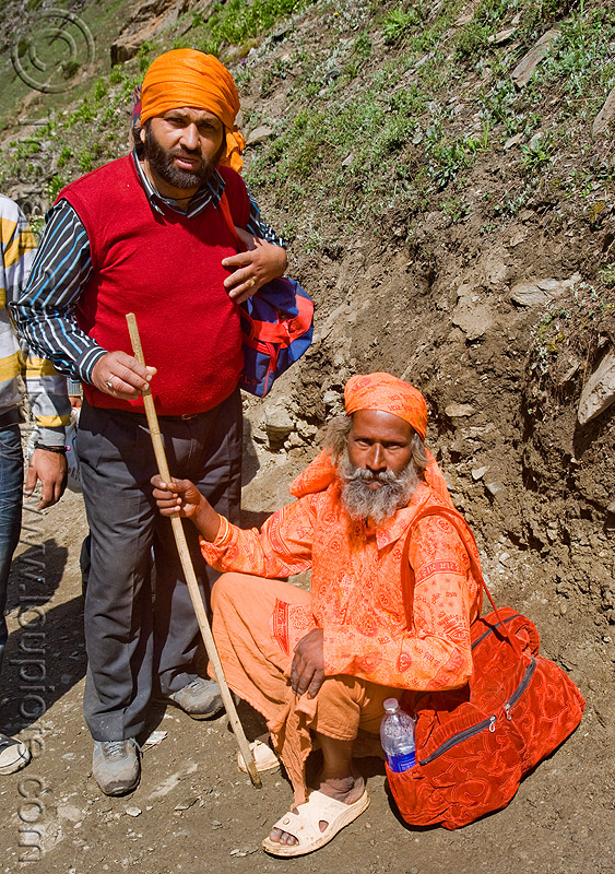 pilgrim and sadhu (hindu holy man) - amarnath yatra (pilgrimage) - kashmir, amarnath yatra, baba, hiking cane, hindu holy man, hinduism, kashmir, mountain trail, mountains, pilgrim, pilgrimage, sadhu, trekking, walking stick, yatris, अमरनाथ गुफा