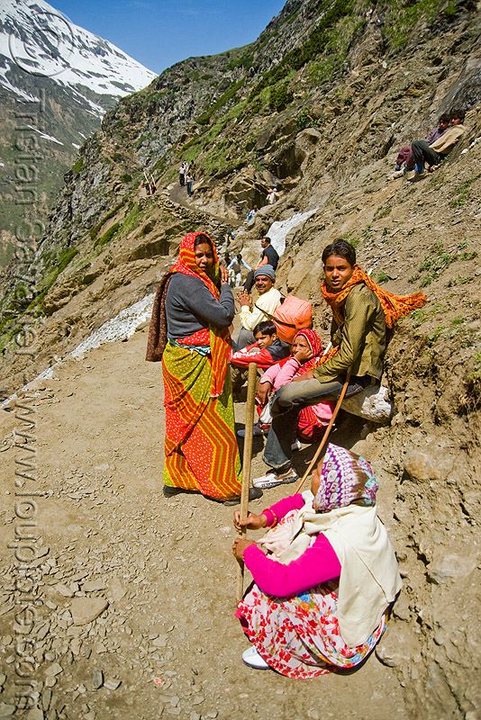 pilgrims resting on trail - amarnath yatra (pilgrimage) - kashmir, amarnath yatra, hiking canes, kashmir, mountain trail, mountains, pilgrimage, pilgrims, resting, trekking, walking sticks, yatris, अमरनाथ गुफा