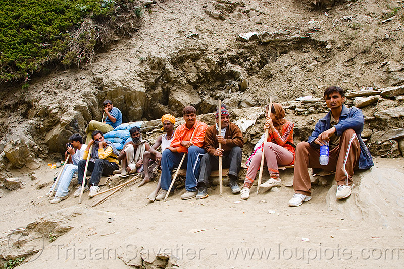 pilgrims with walking sticks resting on trail - amarnath yatra (pilgrimage) - kashmir, amarnath yatra, hiking canes, kashmir, mountain trail, mountains, pilgrimage, pilgrims, resting, trekking, walking sticks, yatris, अमरनाथ गुफा