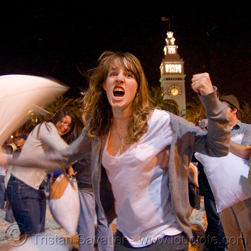 pillow warrior girl - the great san francisco pillow fight 2009, down feathers, embarcadero clock tower, night, people, pillow fight club, pillows, woman, world pillow fight day