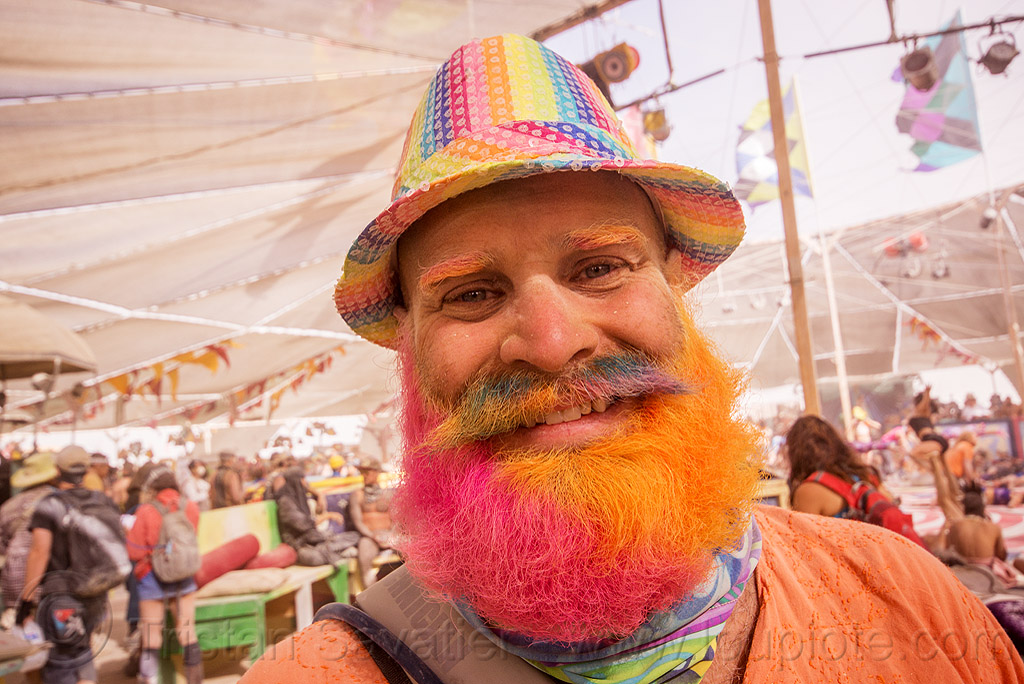 pink and orange beard - burning man 2015, center camp, hat, people, rainbow colors, rainbow hat, rainbow mustache