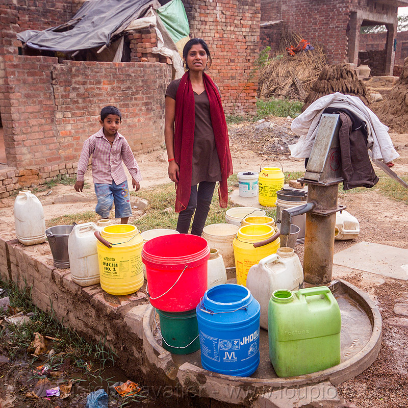 plastic water containers near hand pump (india), boy, child, hand pump, india, khoaja phool, kid, plastic jugs, village, water jugs, water pump, woman, खोअजा फूल
