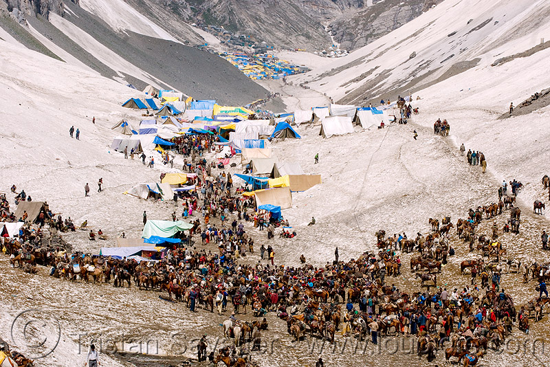 ponies and pilgrims on the trail - amarnath yatra (pilgrimage) - kashmir, amarnath yatra, encampment, glacier, hiking, hindu pilgrimage, horses, india, kashmir, kashmiris, mountain trail, mountains, pilgrims, ponies, pony station, snow, tents, trekking