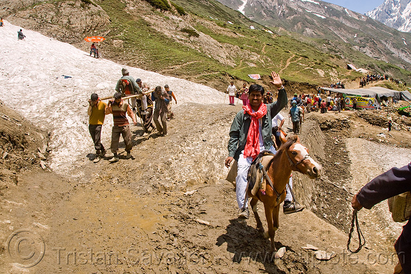 ponies and pilgrims on the trail - amarnath yatra (pilgrimage) - kashmir, glacier, horse-riding, horseback riding, horses, kashmiris, mountain trail, mountains, people, porters, snow, trekking, wallahs, yatris, अमरनाथ गुफा
