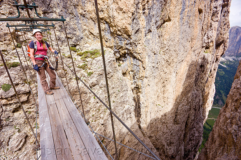 ponte tridentina - footbridge - via ferrata tridentina (dolomites), alps, bridge, catwalk, chasm, cliff, climber, climbing, climbing harness, climbing helmet, crossing bridge, dolomiti, mountain climbing, mountaineer, mountaineering, mountains, people, rock climbing, suspension bridge, vertical, via ferrata brigata tridentina, woman