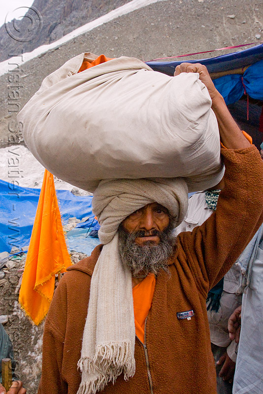 porter with bag on head - amarnath yatra (pilgrimage) - kashmir, amarnath yatra, bag, bearer, carrying on the head, kashmir, man, pilgrim, pilgrimage, porter, trekking, wallah, yatris, अमरनाथ गुफा