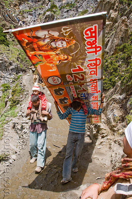 porter with large sign on trail - amarnath yatra (pilgrimage) - kashmir, amarnath yatra, bearer, kashmir, men, mountain trail, mountains, pilgrimage, pilgrims, porter, sign, trekking, wallah, yatris, अमरनाथ गुफा