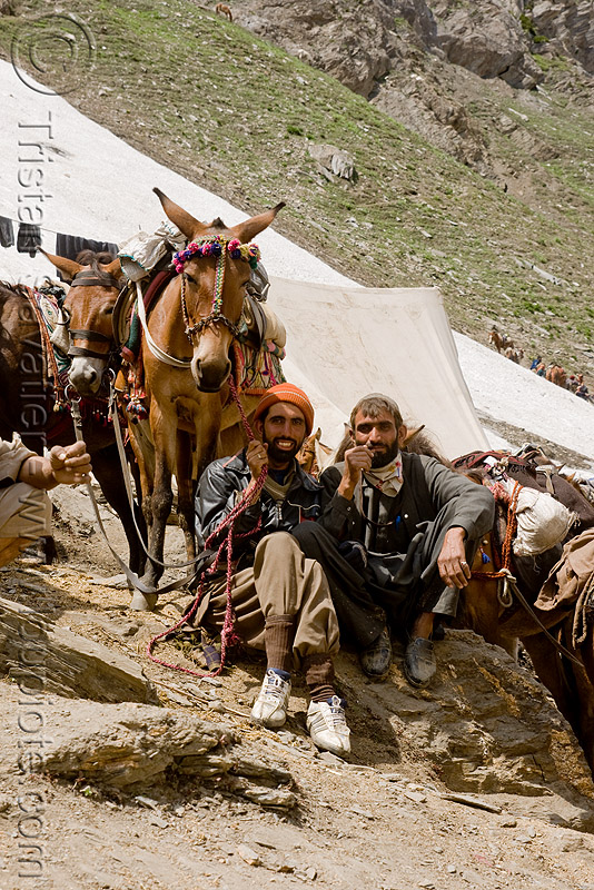 porters and their ponies - amarnath yatra (pilgrimage) - kashmir, amarnath yatra, caravan, glacier, hiking, hindu pilgrimage, horses, india, kashmir, kashmiris, mountain trail, mountains, pilgrims, ponies, snow, trekking