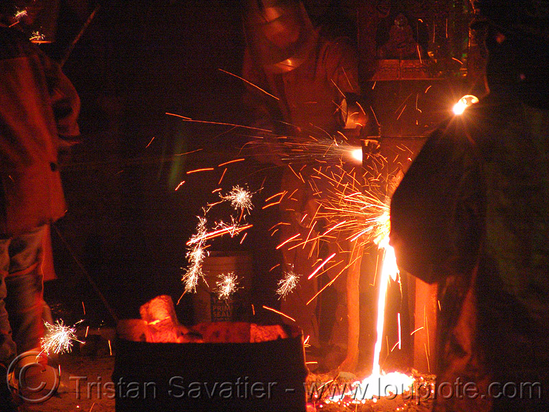 pouring molten metal - foundry, crucible, molten iron, sparks