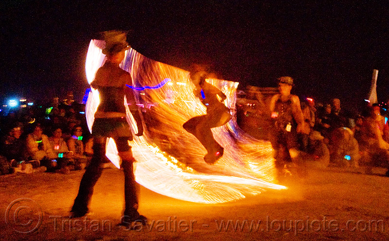 procession ceremonial flame - fire conclave - fire jumping rope - burning man 2009, fire conclave, fire dancer, fire dancing, fire jumping rope, fire performer, fire rope, fire spinning, flames, night of the burn, rope jumping, skipping rope, spinning fire