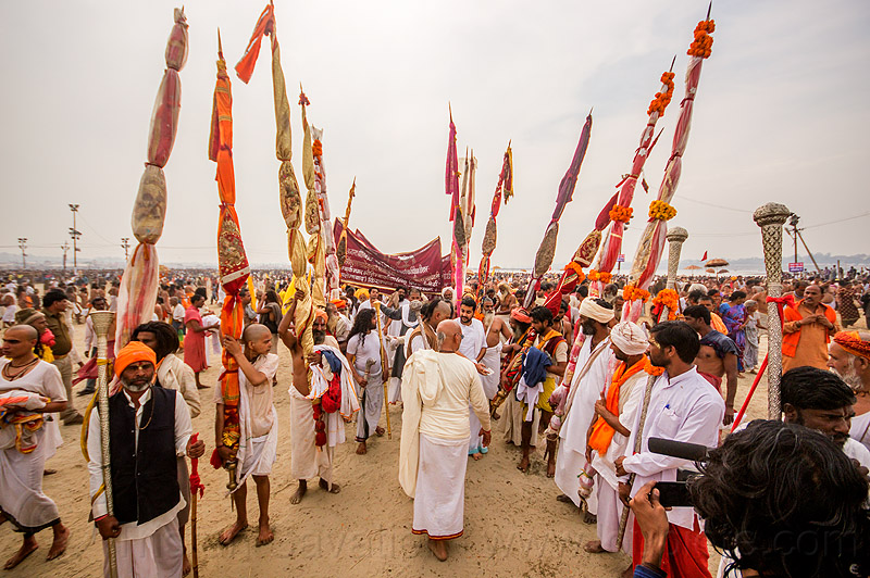procession with ceremonial poles near the sangam - kumbh mela 2013 festival (india), babas, ceremony, crowd, hindu, hinduism, kumbha mela, maha kumbh mela, men, poles, procession, rows, sadhu, triveni sangam, vasant panchami snan