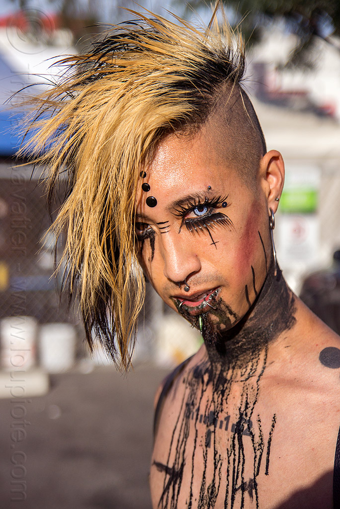 punk style makeup, bindis, color contact lenses, color contacts, cyber bites piercing, darik, derrick demolition, eyebrow piercing, fashion, folsom street fair, lip piercing, man, punk, snake bites piercing, special effects contact lenses, theatrical contact lenses