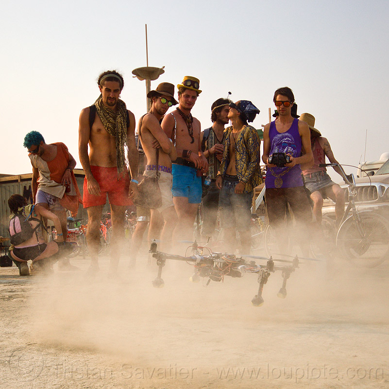 quadcopter landing - remote controlled drone - burning man 2013, burning man, drone, dust, flying, landing, men, multicopter, quadcopter, quadrocopter, quadrotor helicopter, rc, remote controlled, uav, unmaned aerial vehicle, video camera, virtual reality goggles, vr goggles