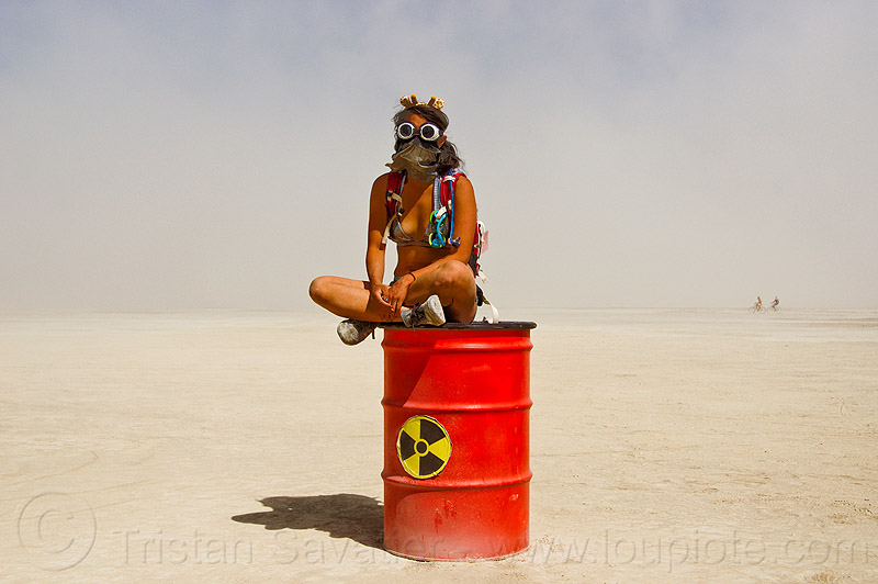 radioactive waste drum - burning man 2013, barrel, goggles, nuclear waste, people, playa, red, sitting, unidentified art, woman