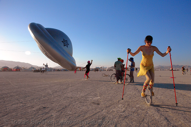 the raelians flying saucer - burning-man 2006, art, burning man, people, raeliens, ufo, unicycle, woman