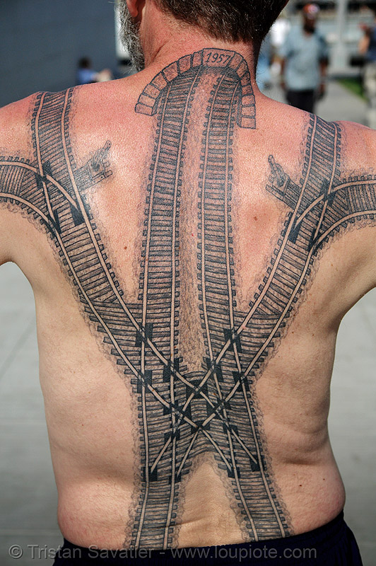 railroad back tattoo - rail tracks switches - backpiece, darryl, freight hopping, full body tattoos, people, railroad switch, railroad tattoo, railroad tracks, rails, railway, railway tracks, skin, tattooed, train tracks, train tunnel