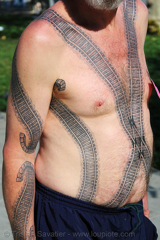 railroad tattoo - chest and arm, chest tattoo, darryl, freight hopping, frog, full body tattoos, people, rail tracks, railroad switch, railroad tracks, rails, railway, railway frog, railway tracks, skin, tattooed, torso, train tracks, train tunnel