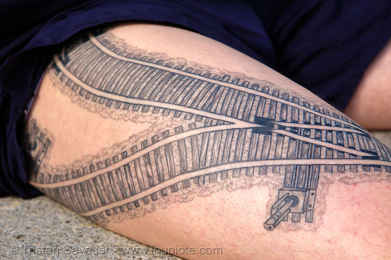 railroad tattoo - rails switch - thigh, darryl, freight hopping, full body tattoos, leg, rail tracks, railroad switch, railroad tattoo, railroad tracks, rails, railway tracks, skin, tattooed, thigh, train tracks, tunnel