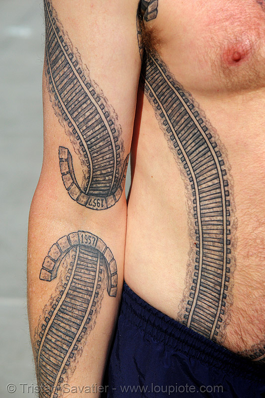 railroad tattoo - train tunnel - arm, arm, darryl, freight hopping, full body tattoos, rail tracks, railroad switch, railroad tattoo, railroad tracks, rails, railway tracks, skin, tattooed, torso, train tracks, train tunnel