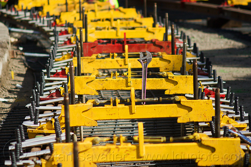 railroad track construction, alignment tools, duboce, light rail, muni, ntk, rail jacks, railroad construction, railroad tracks, railway tracks, san francisco municipal railway, track jacks, track maintenance, track work, wrench, yellow