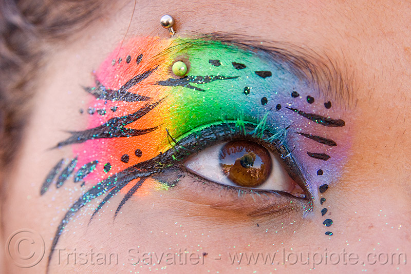 rainbow eye makeup, dolores park, eye makup, eyebrow piercing, face painting, facepaint, gay pride festival, glitter, rainbow colors, rainbow makeup, woman