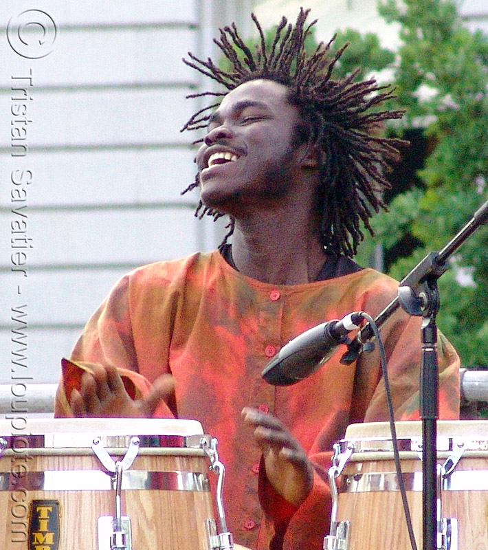rasta drummer with conga drums, african american man, black man, dreadlocks, dreads, reggae
