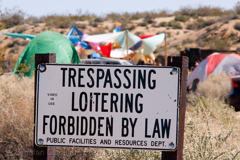 rave party in the desert, dancing, desert party, no trespassing, psy trance, public facilities and resources dept., rave party, sign, trespassing loitering forbidden by law, video in use