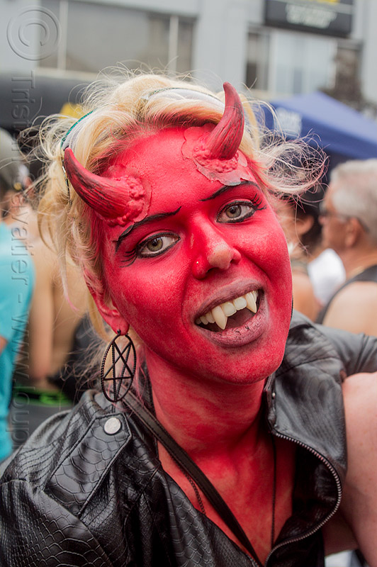 red devil makeup - horns - fangs, blonde, devil horns, face paint, face painting, fake horns, fangs, folsom street fair, make-up, prosthetic horns, red devil, woman