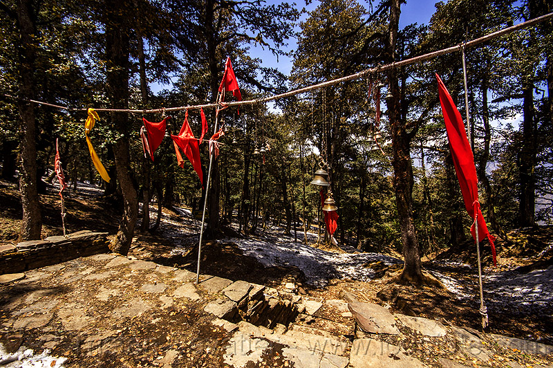 red flags and bells at hindu shrine in mountain forest (india), bells, forest, hinduism, india, mountains, red flags, shrine
