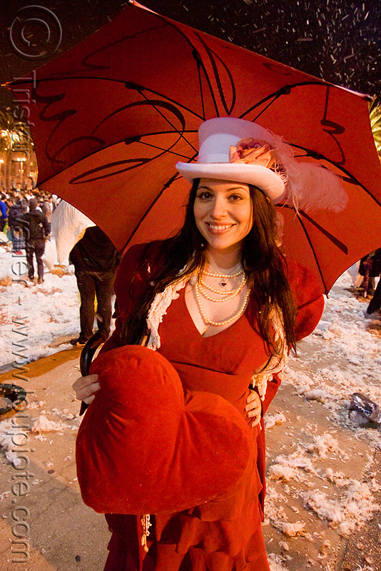 red heart woman with umbrella - diana furka - the great san francisco pillow fight 2009, diana furka, down feathers, heart pillow, night, pillow fight club, pillows, red color, red umbrella, woman, world pillow fight day