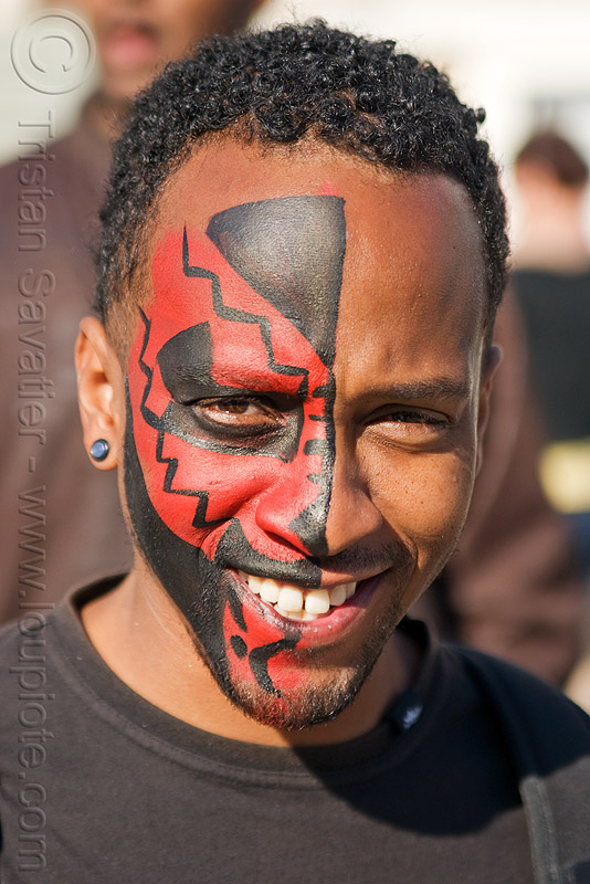 red tribal face paint - half-face, african american man, black man, carnival, half face, red, tribal facepaint