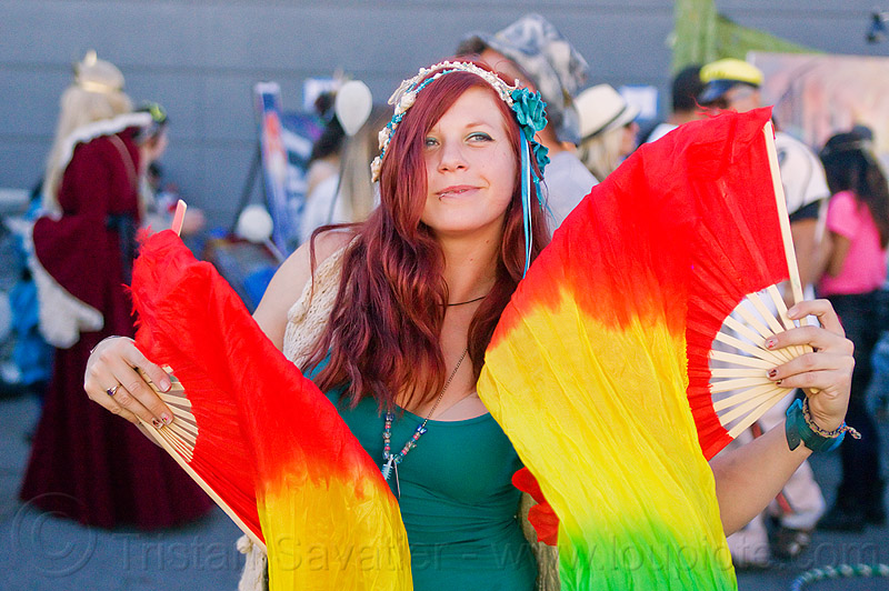 redhead woman dancing with fans, burning man decompression, fans, michelle, rainbow colors, redhead, woman