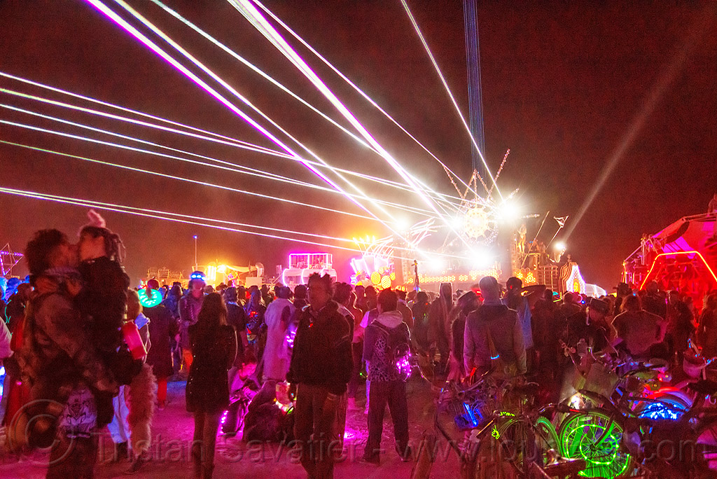 revelers dancing on the night of the burn - burning man 2016, burning man, dancing, mutant vehicles, night, unidentified art car, white lasers