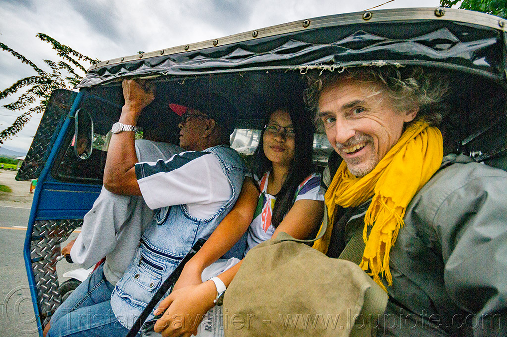 riding an overloaded motorized tricycle (philippines), motorbike, motorcycle, motorized tricycle, passengers, philippines, self portrait, selfie, sidecar, sitting, tristan savatier