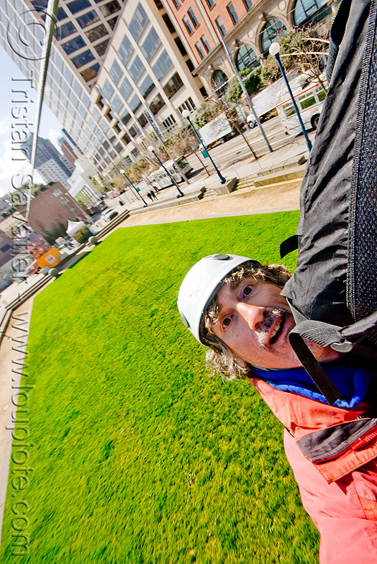 riding the zip-line over san francisco, adventure, cable line, cables, embarcadero, extreme sport, gear, grass, hanging, harness, helmet, justin herman plaza, landing, lawn, man, mountaineering, self portrait, selfie, steel cable, tristan savatier, trolley, turf, tyrolienne, urban, zip line, zip wire, ziptrek