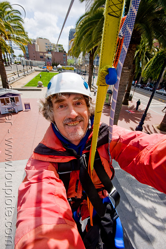 riding the zip-line over san francisco, adventure, cable line, cables, climbing helmet, embarcadero, extreme sport, gear, hanging, harness, justin herman plaza, man, mountaineering, self portrait, sling, steel cable, strap, tristan savatier, trolley, tyrolienne, urban, zip line, zip wire, ziptrek