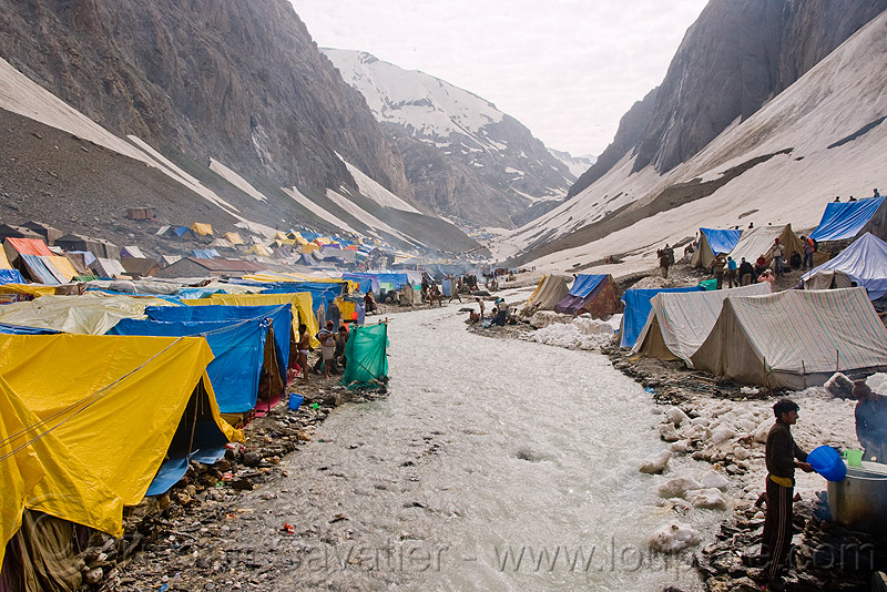 river and tent village near the cave - amarnath yatra (pilgrimage) - kashmir, amarnath yatra, encampment, hiking, hindu pilgrimage, india, kashmir, mountains, pilgrims, river bed, tents, trekking