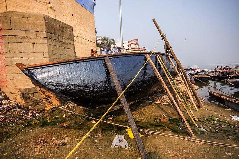 river boat with new tar coating - ghats of varanasi (india), drying, ganga, ganges river, ghats, hull, india, river boat, tar, varanasi
