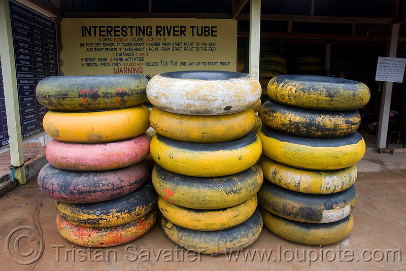 river tubing in vang vieng (laos), inner tubes, stacked, stacks, yellow
