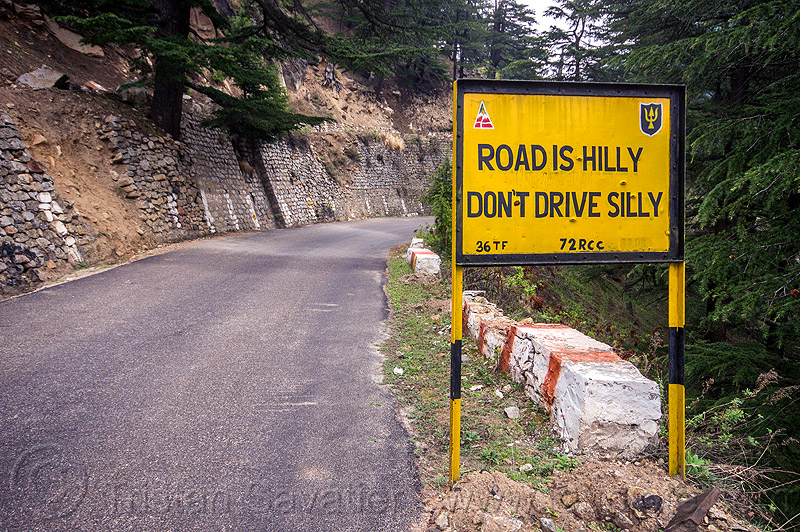 road is hilly, don't drive silly - BRO road sign (india), bhagirathi valley, border roads organisation, bro road signs, india, mountain road, mountains, road sign